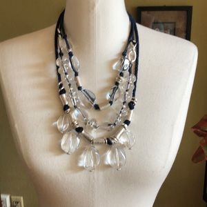 Chico's beautiful clear white beads w blue piping.